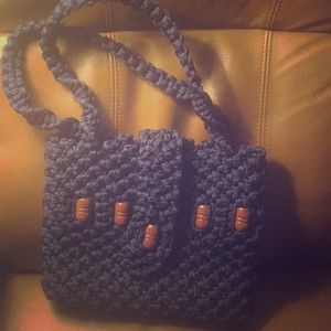Navy crochet purse with brown wooden beads.